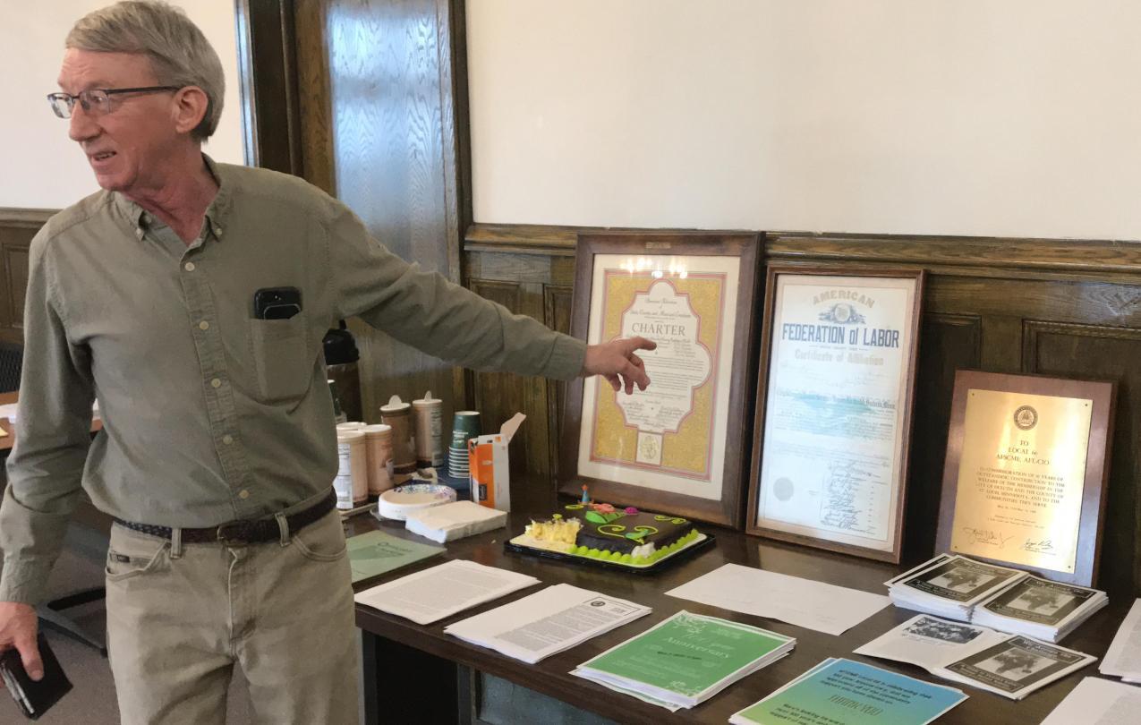 Retired Local 66 President Alan Netland presenting Local 66 charters