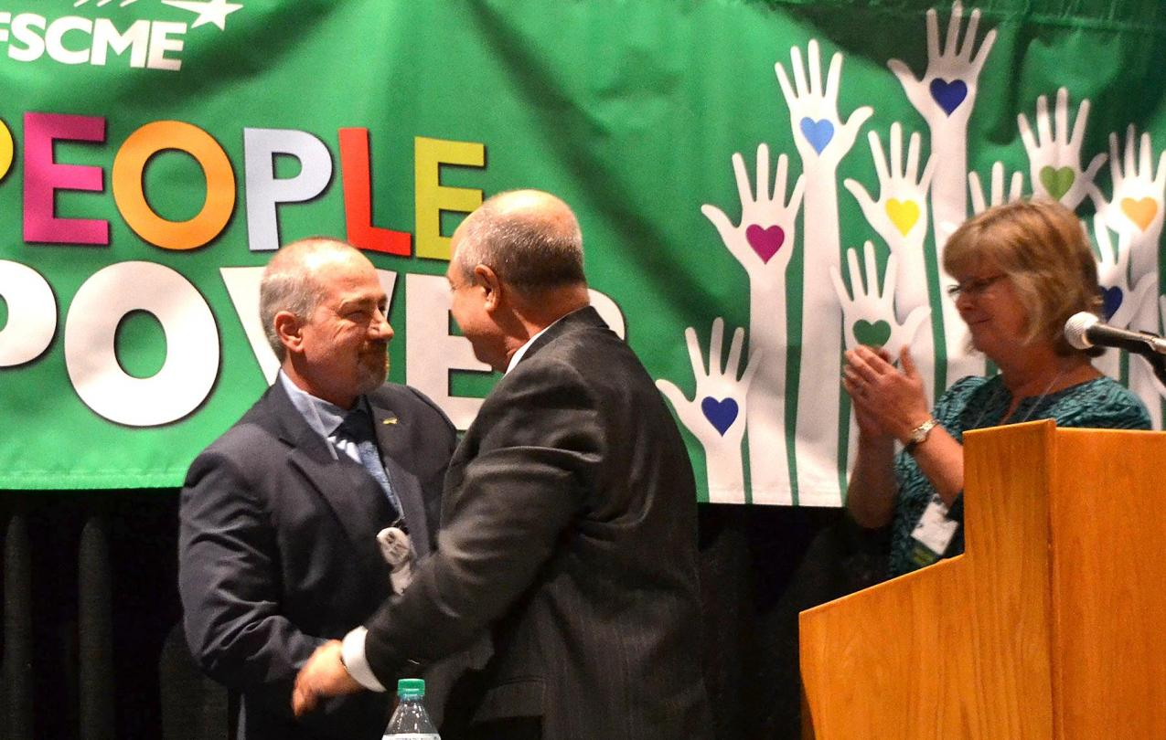 AFSCME Council 5 executive director Eliot Seide (center), who is retiring, and president Judy Wahlberg welcome the new executive director, John Westmoreland (left).