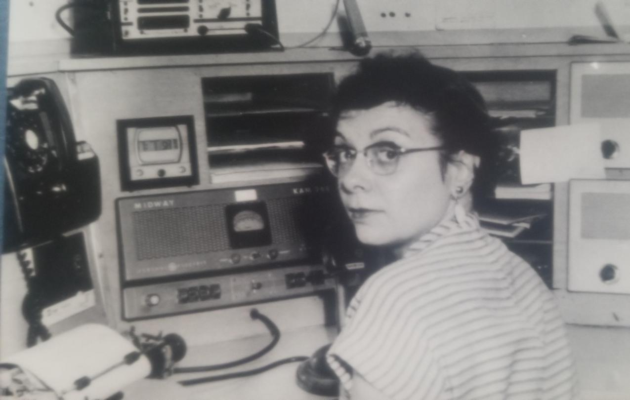 Mitzie Pernu at the radio while on the job as a 911 dispatcher in 1963